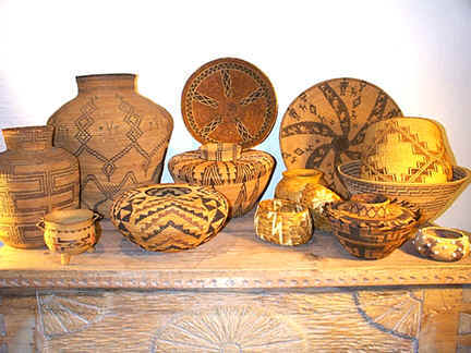 Indian baskets from Len Wood's Indian Territory Gallery in Laguna Beach, California include examples from throughout the Western USA. These early museum-quakity ,investment- grade examples include many forms and technologies that disappeared after the Great Depression of the 1930's. All the baskets in this photo date circa1860-1930 and include Chumash, Yokuts, Pauite, Washo, Mission and Apache among others. Click photo to view our current catalog of antique baskets for sale.