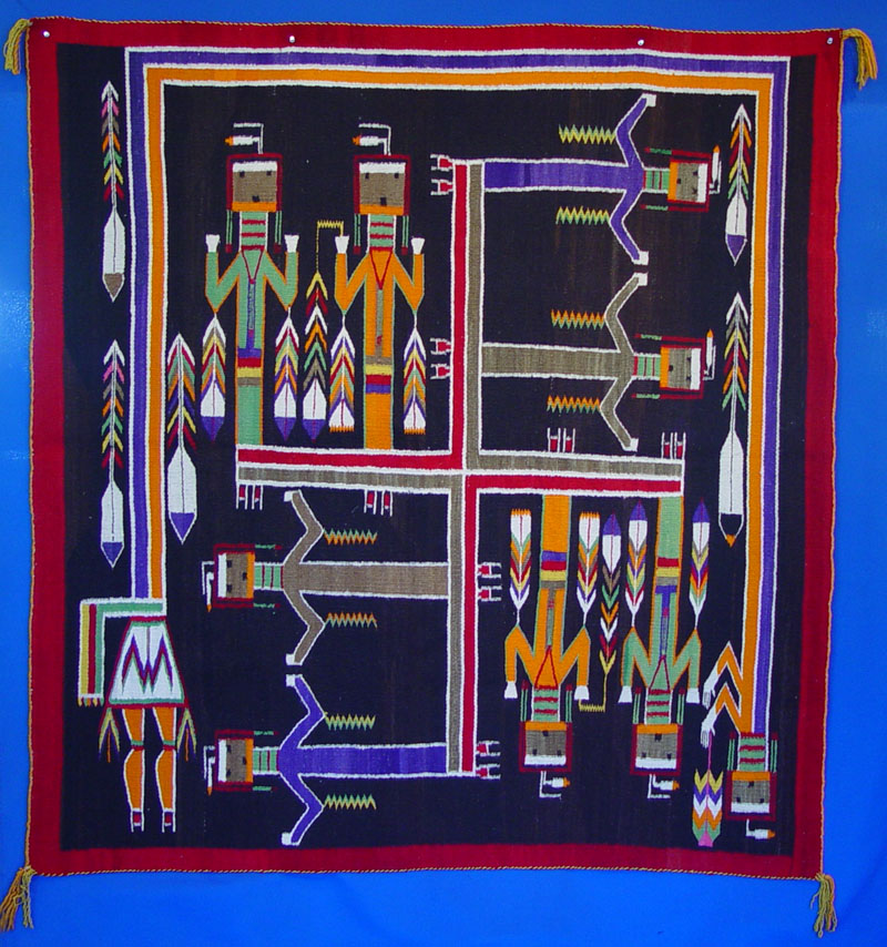 http://indianterritory.com/images/rugs/sandpaintingrug/1298-01a.JPG